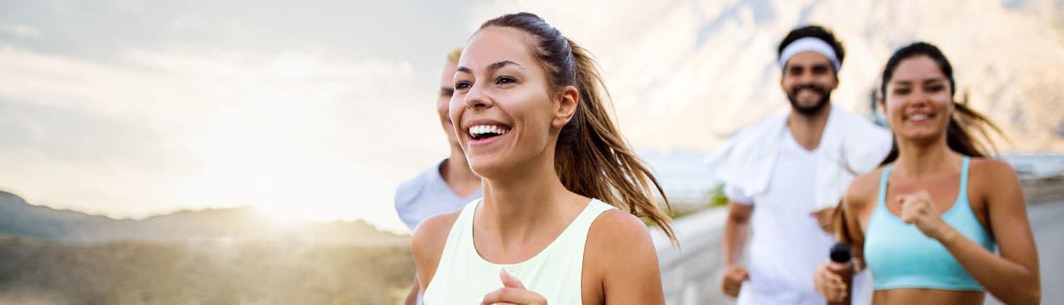 Young group of people jogging